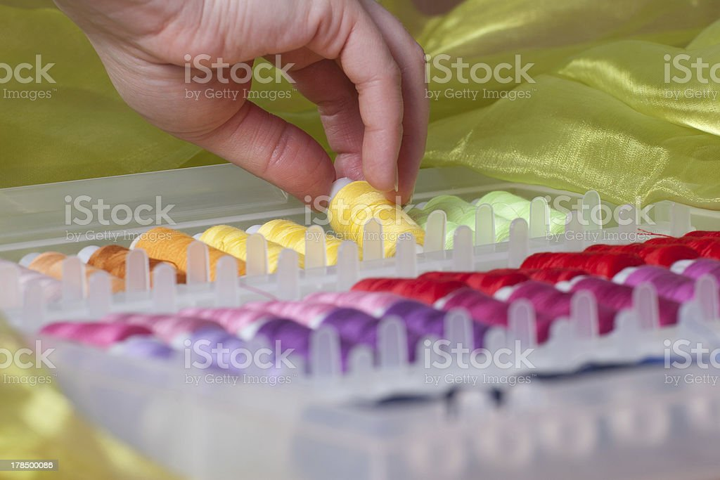 Picking a Spool from Set stock photo