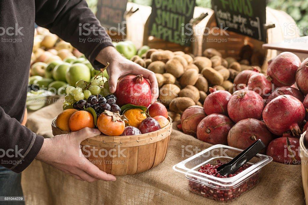 Picking fresh fruit at Farmers Market stock photo