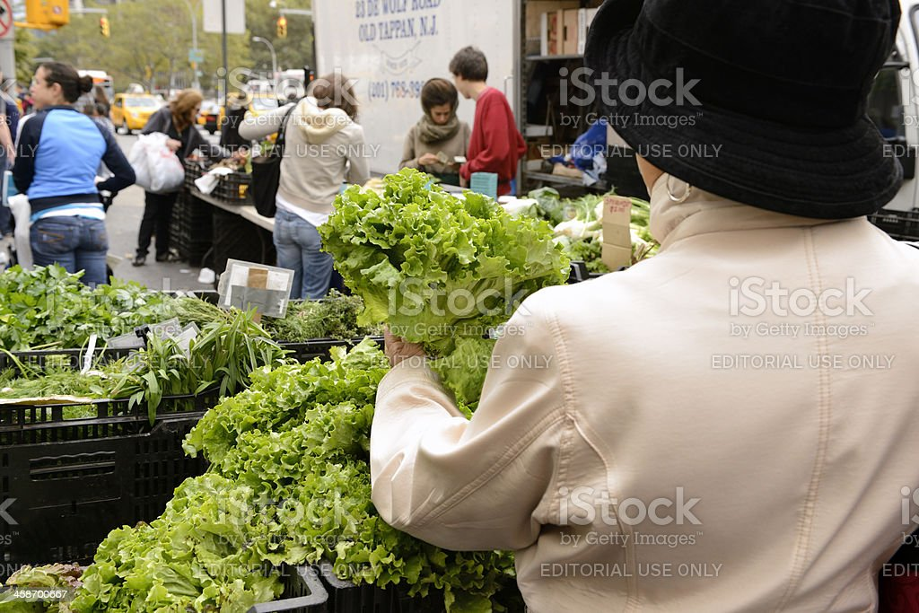 Picking out Produce at the Farmer's Market stock photo