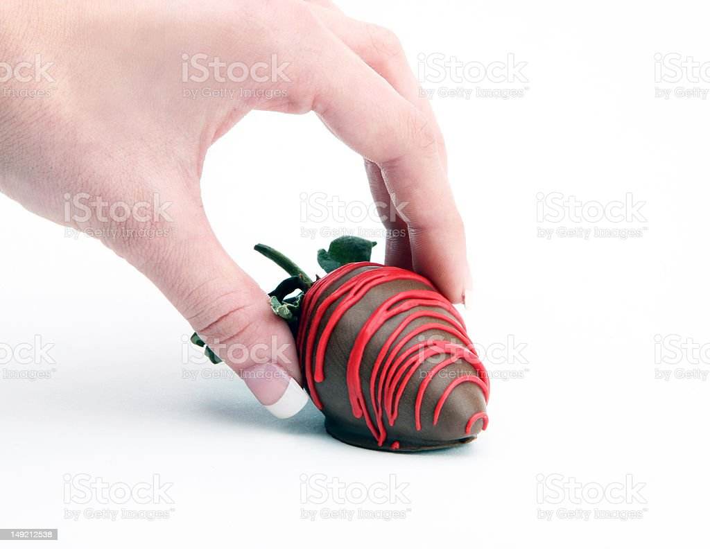 Picking up a chocolate covered strawberry stock photo
