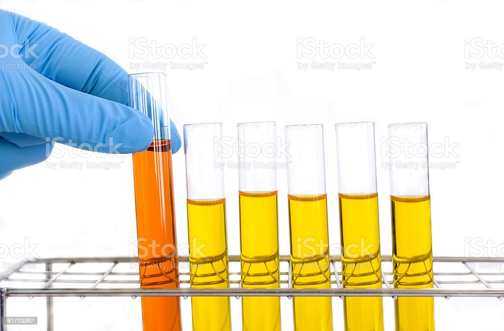 Picking up a test tube stock photo