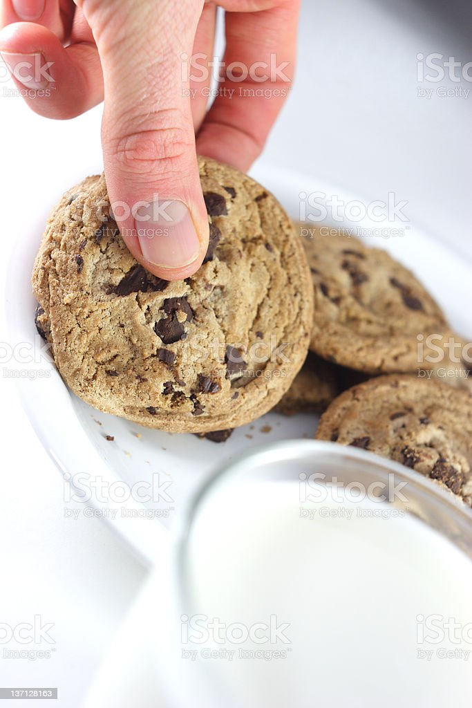 Picking up cookie royalty-free stock photo