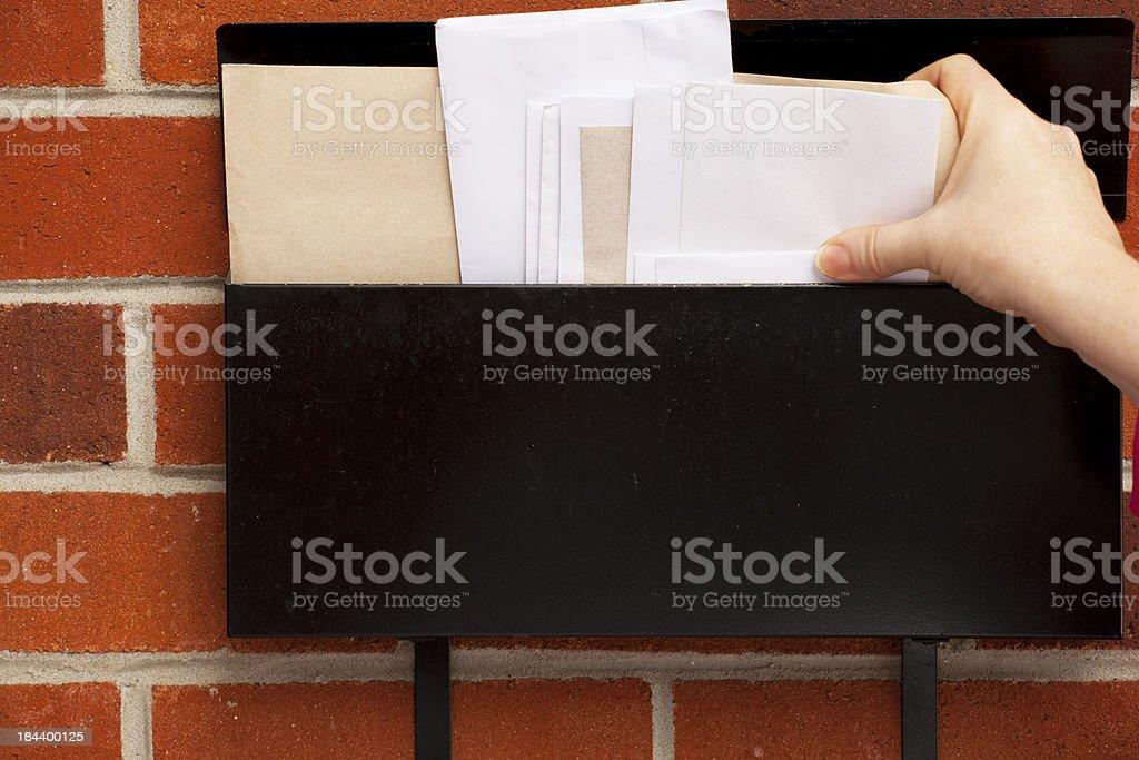 Picking up Mail stock photo
