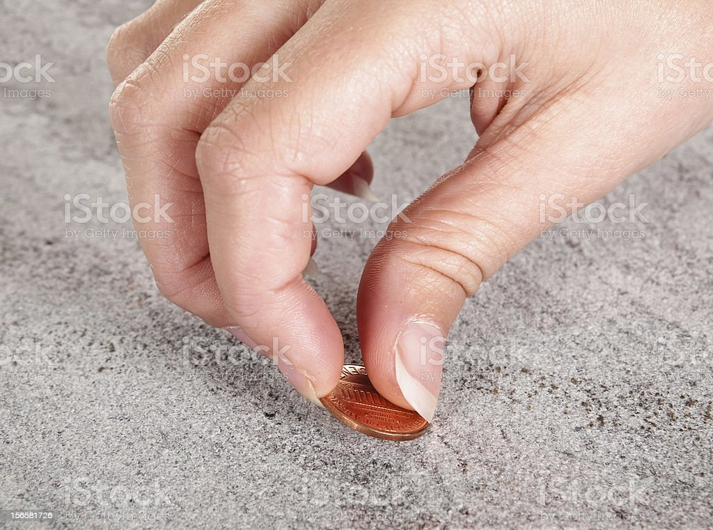 Picking up money stock photo