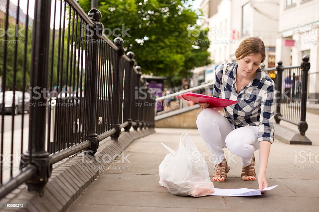 picking up papers royalty-free stock photo
