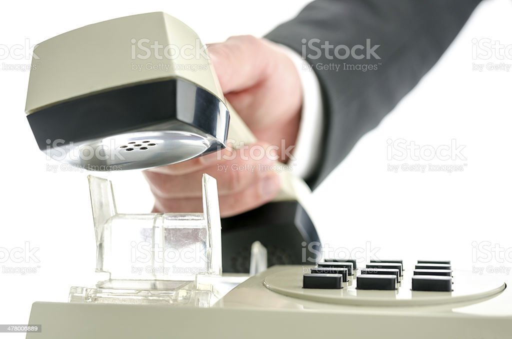 Picking up telephone receiver stock photo