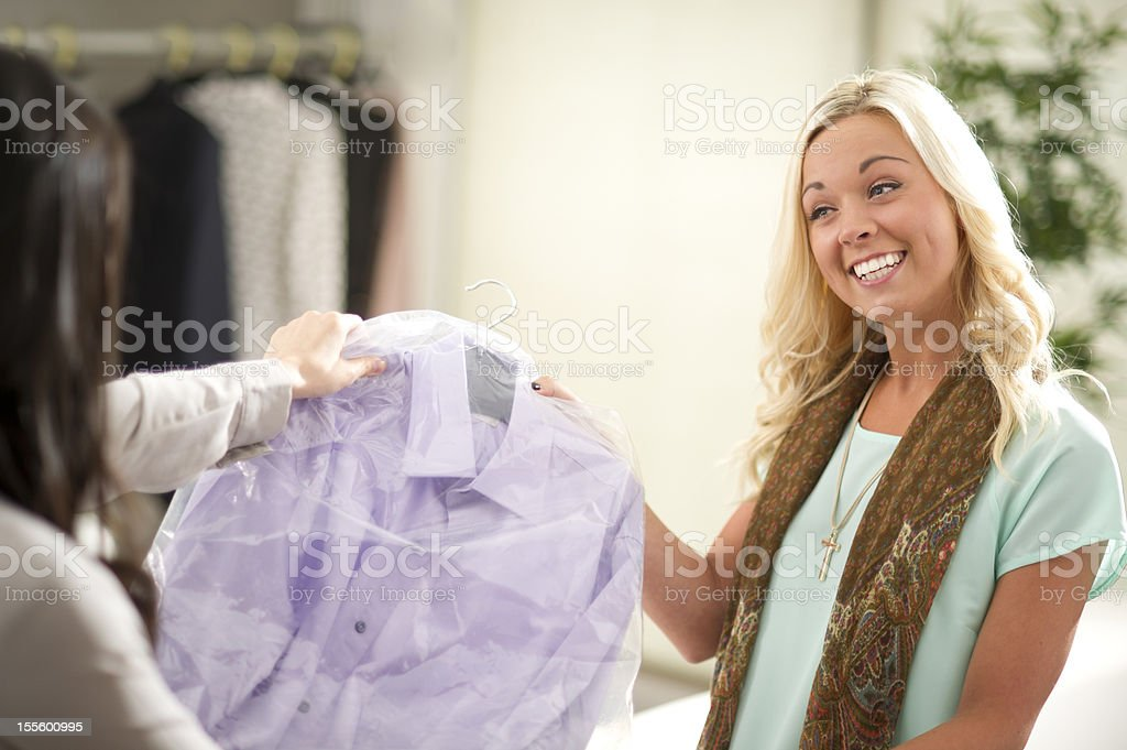 picking up the dry cleaning stock photo