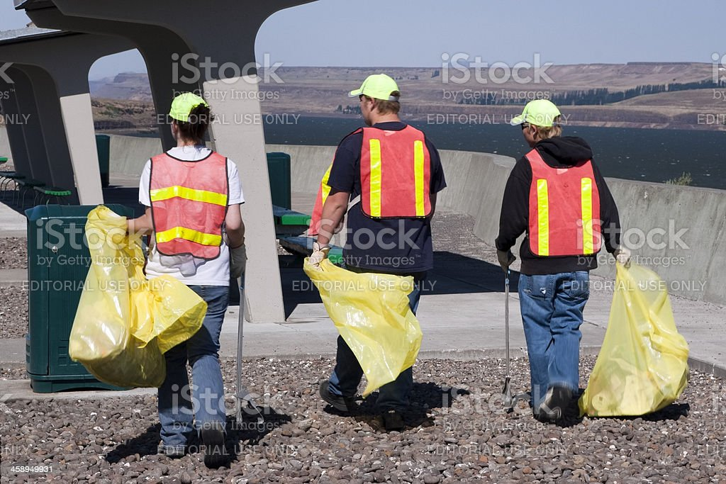 Picking up trash along Columbia River royalty-free stock photo