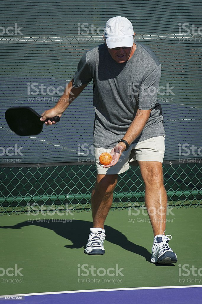 Pickleball Action - Beginning the Serve royalty-free stock photo