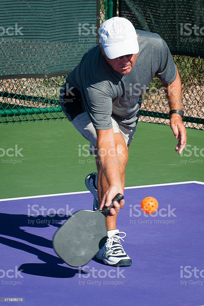 Pickleball Action - Reaching Forehand royalty-free stock photo