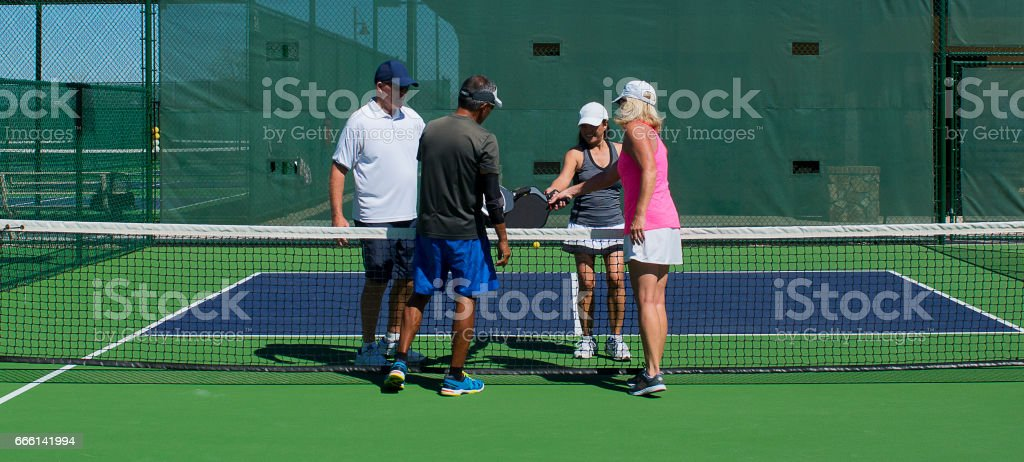 Pickleball - Congratulations of the Completion of a Fun Game stock photo