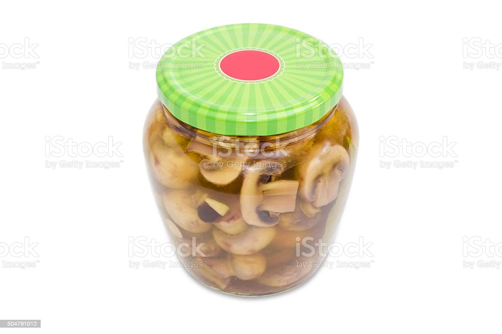 Pickled button mushrooms in glass jar stock photo