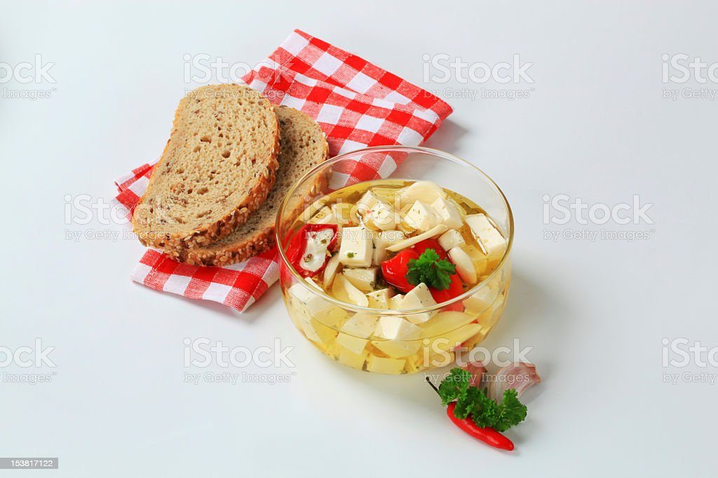 Pickled cheese with bread and vegetables stock photo