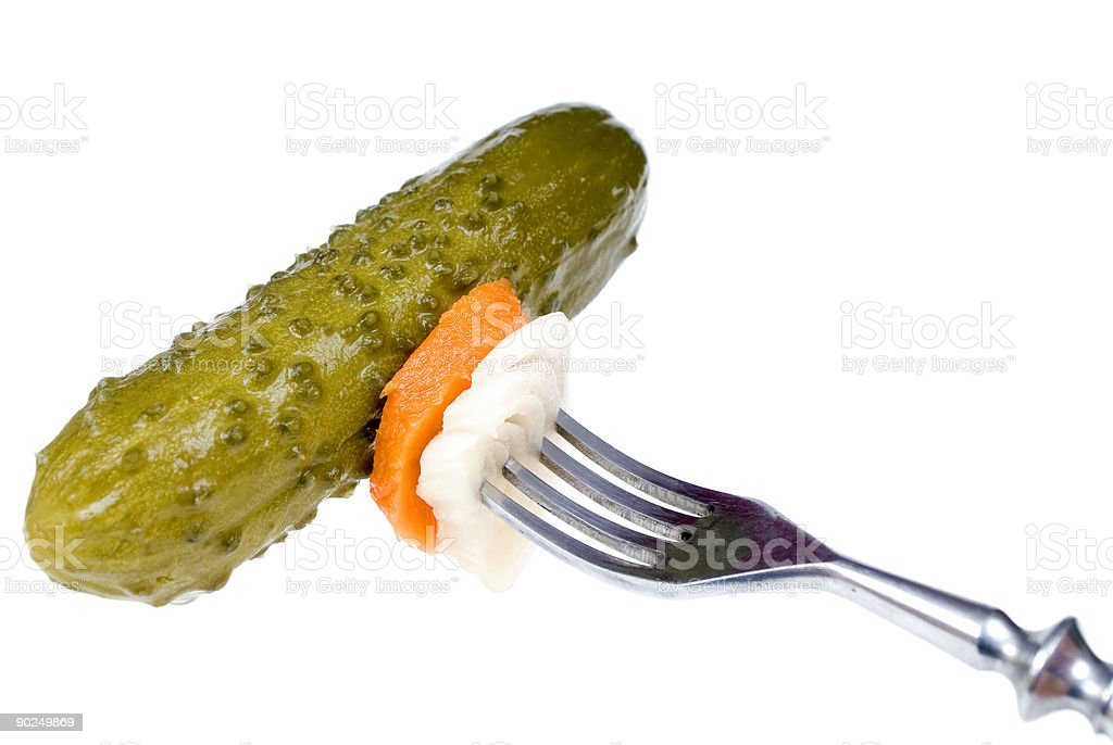 Pickled cucumber on a fork royalty-free stock photo
