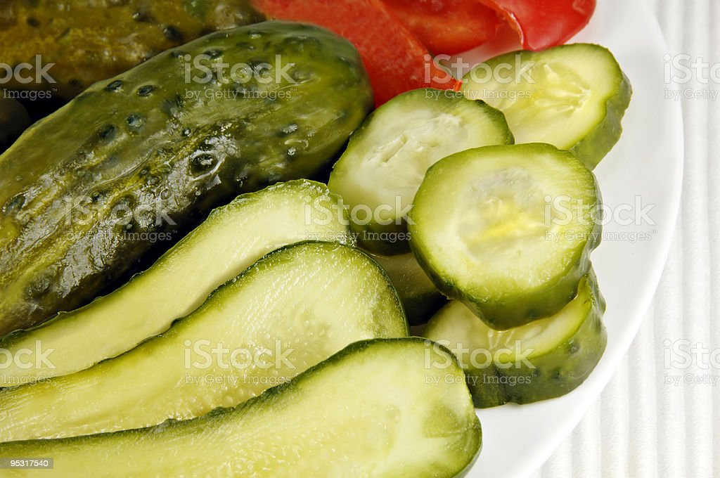 Pickled Cucumbers arranged on a Dish stock photo