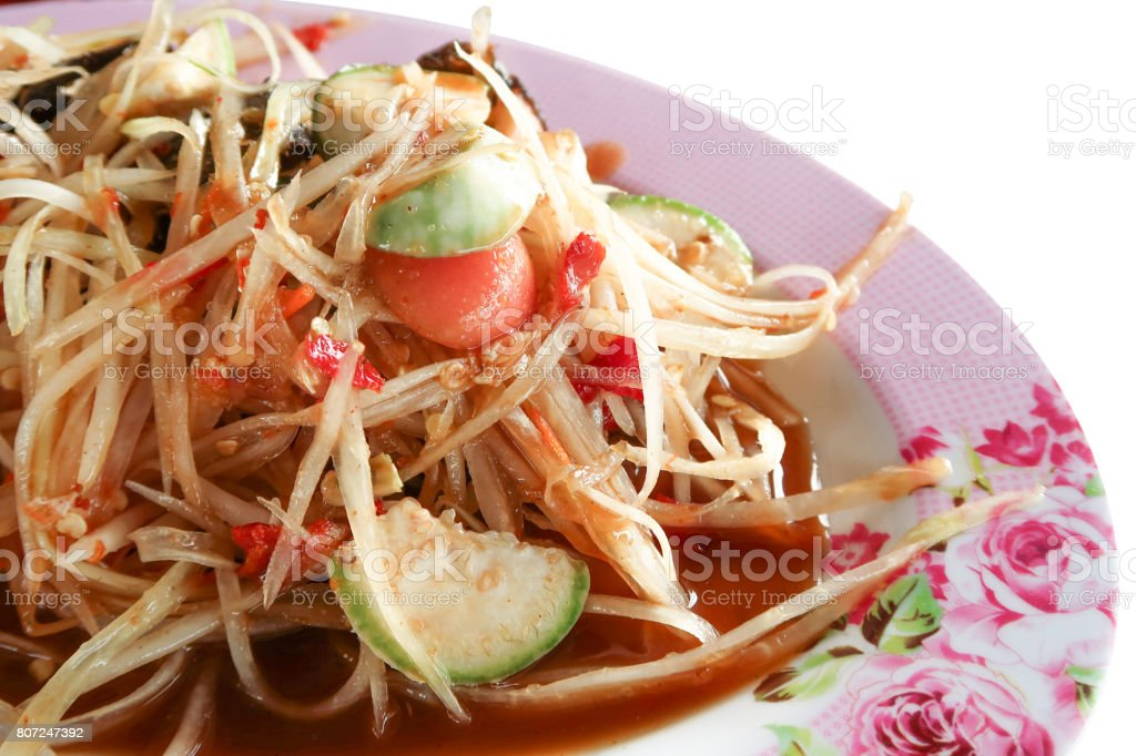 Pickled fish papaya Salad, Som tum, Thai food in pink plate stock photo