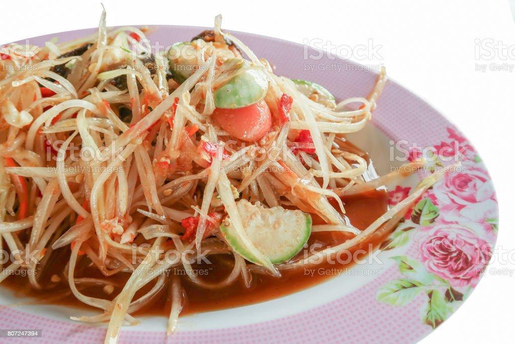 Pickled fish papaya Salad, Som tum, Thai food in pink plate stock photo