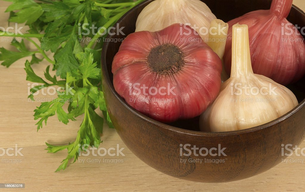 pickled garlic in a wooden bowl royalty-free stock photo