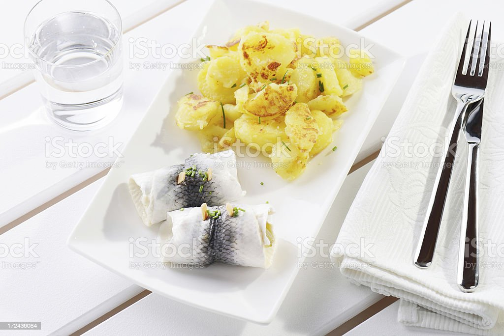 Pickled Herring (Rollmops) and fried potatoes royalty-free stock photo