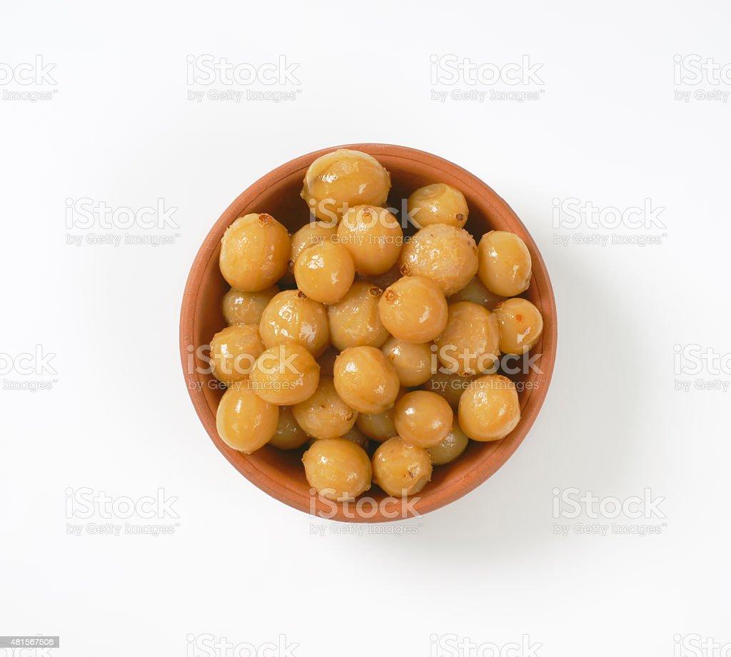 Pickled onions in balsamico vinegar stock photo