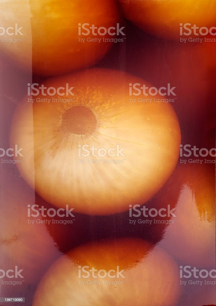 Pickled onions seen through the side of a jar royalty-free stock photo