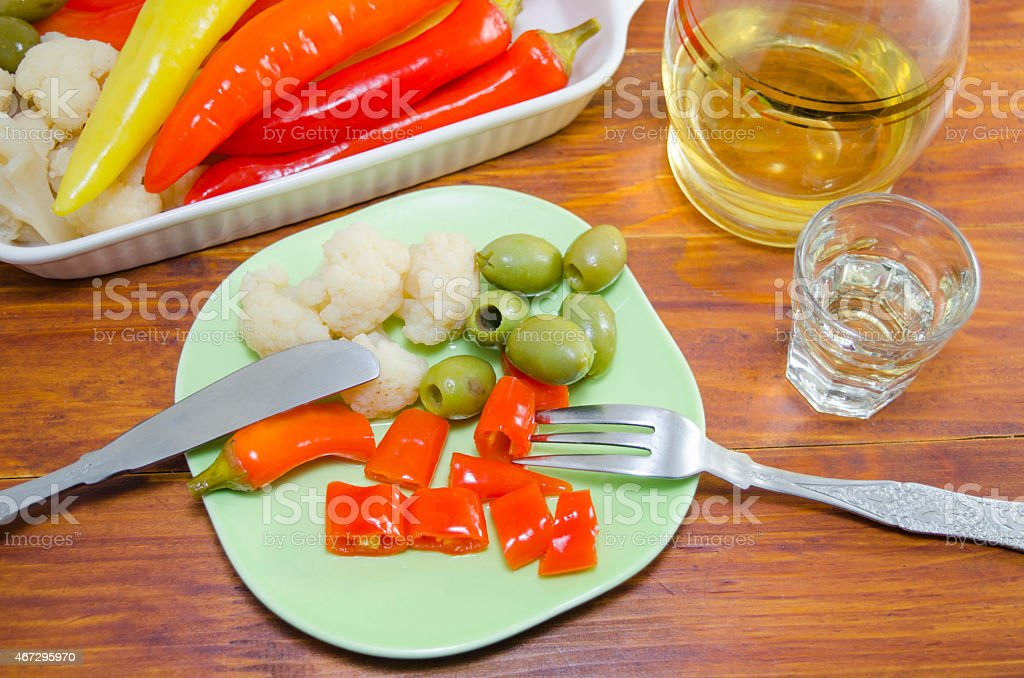 Pickled pepers, cauliflower and olives on a plate royalty-free stock photo