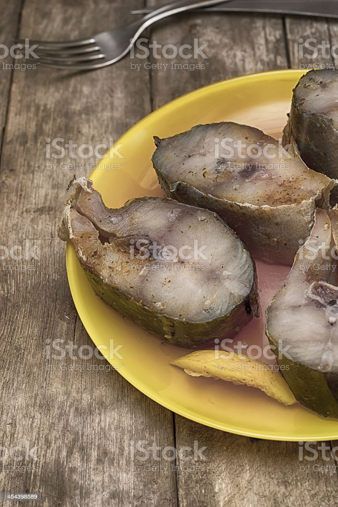 Pickled pieces of fish stock photo