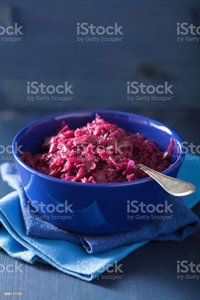 pickled red cabbage in blue bowl stock photo