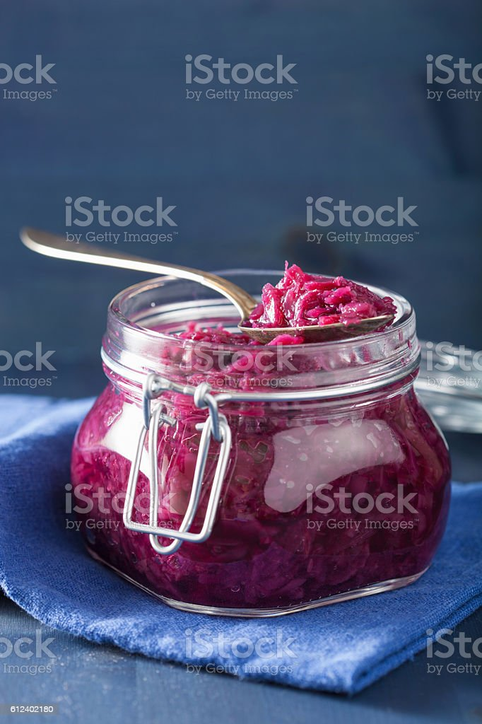 pickled red cabbage in glass jar stock photo