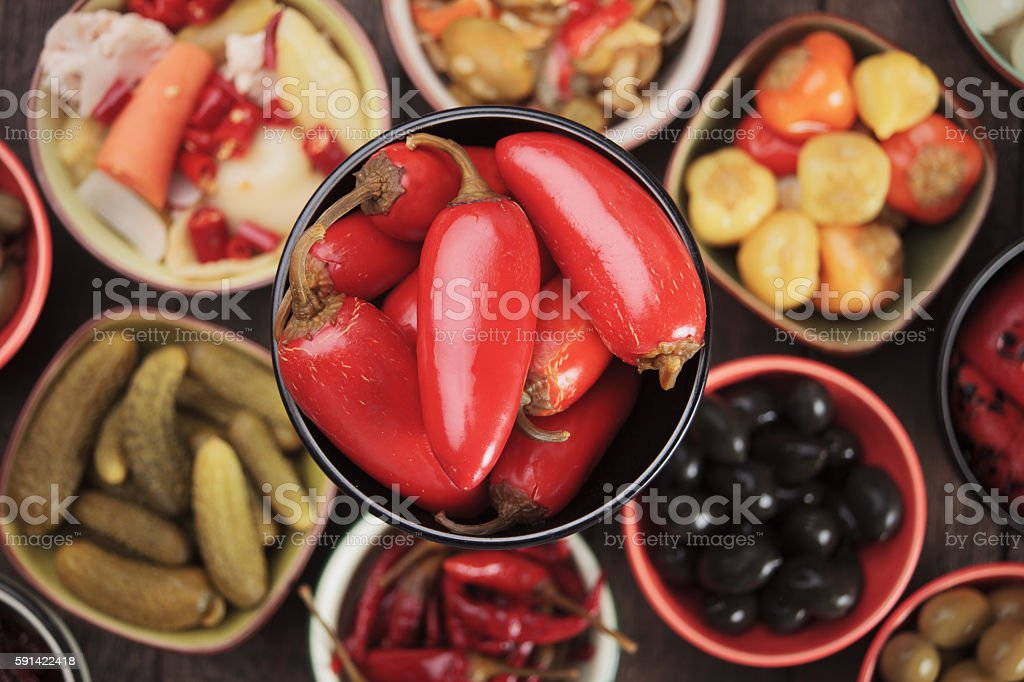 Pickled red jalapenos stock photo