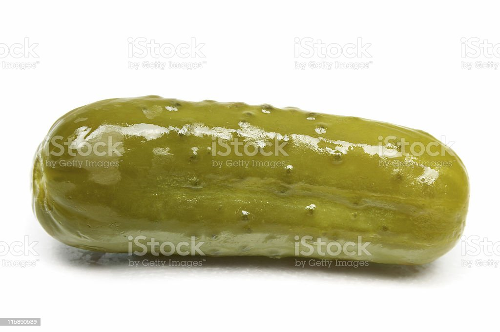 Pickled short cucumber drying one a white surface stock photo