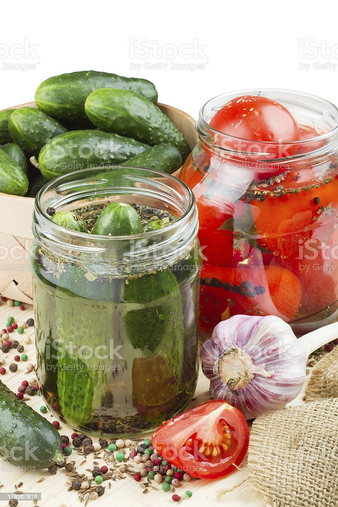 pickled tomatoes and cucumbers stock photo