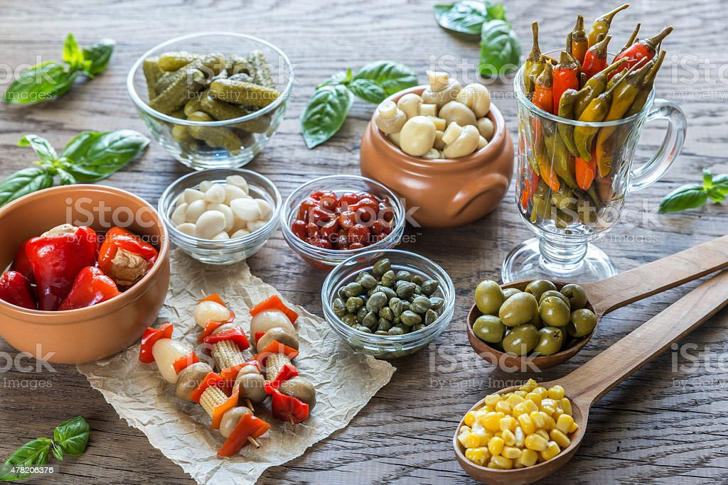 Pickled vegetables on the wooden background stock photo