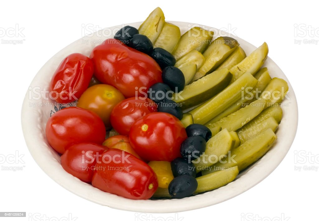 Pickles and salty tomatoes in rural style for the New Year's holiday table. Isolated with patch stock photo