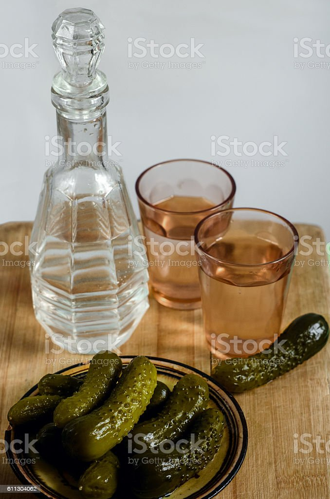 pickles, two glasses, a decanter stock photo