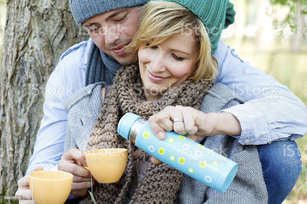picknick couple in forest royalty-free stock photo