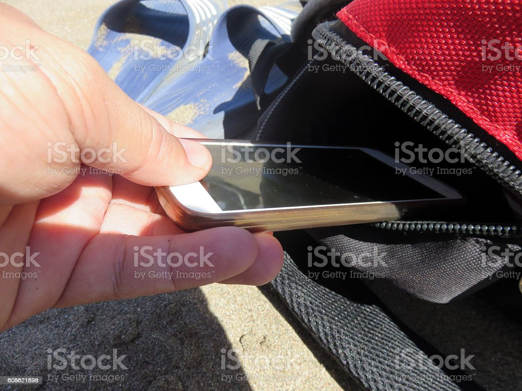 Pickpocket at the beach stock photo