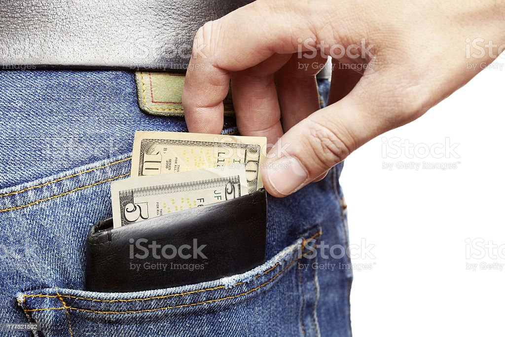 Pickpocket stealing a mans wallet stock photo