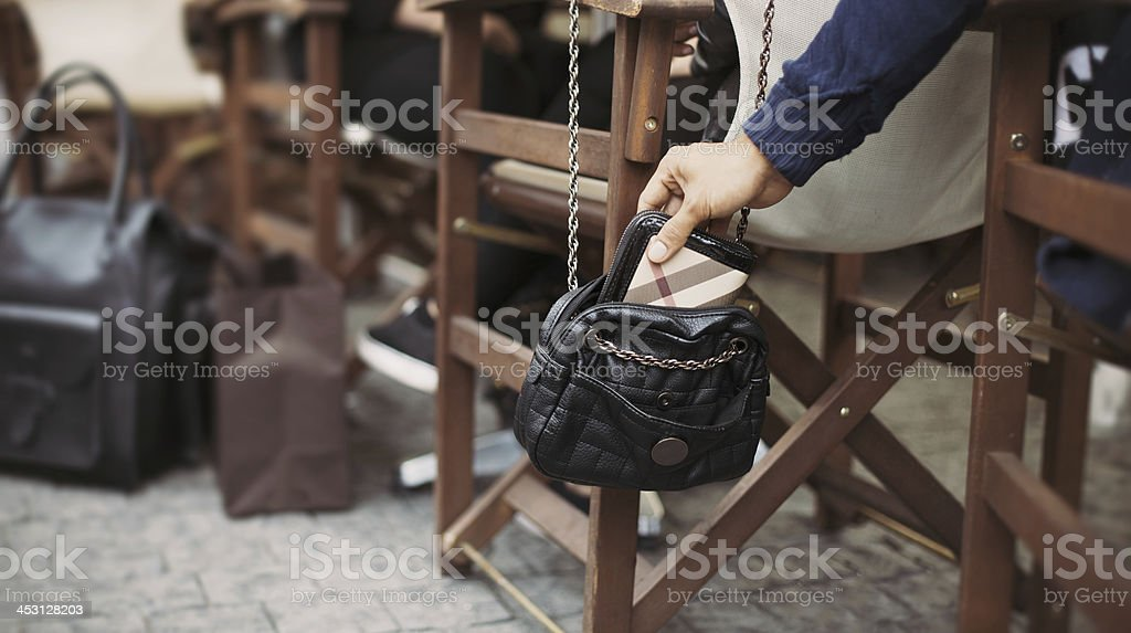 Pickpocketing at the street cafe during daytime stock photo