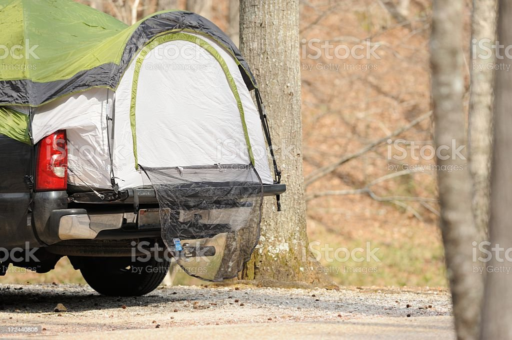 Pickup bed camping tent in campground royalty-free stock photo