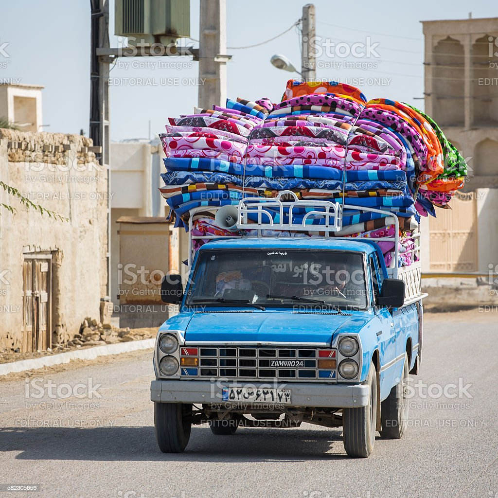 Pickup car loaded with colorful mattresses stock photo
