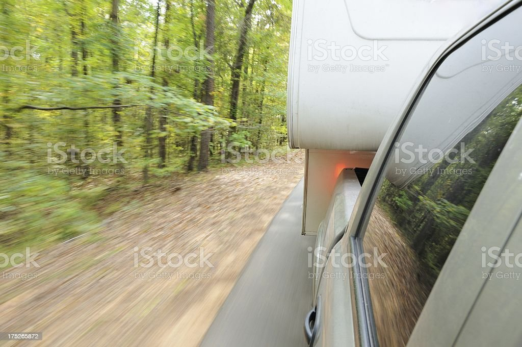 Pickup pulling rv travel trailer with motion blur royalty-free stock photo
