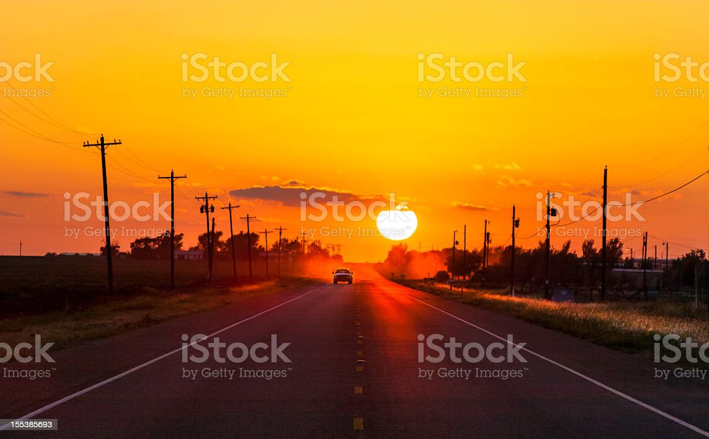 Pickup truck at sunset on West Texas country road stock photo