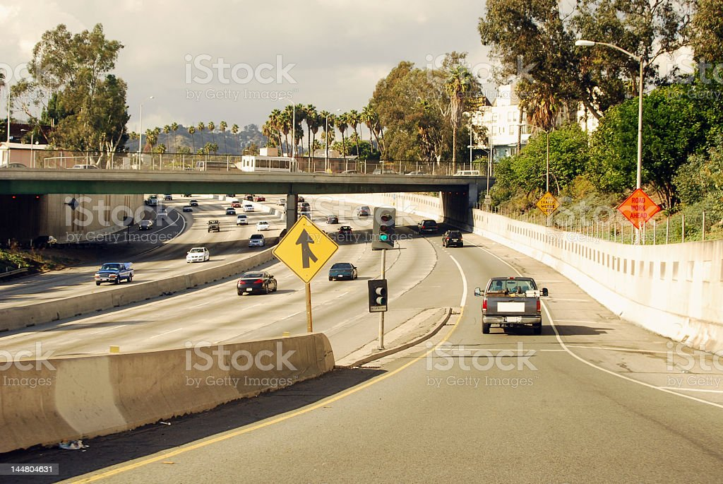 Pick-up truck on a lane merging on the freeway stock photo