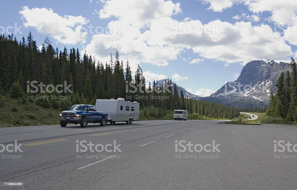 pickup with trailer having a good trip in the rockies stock photo