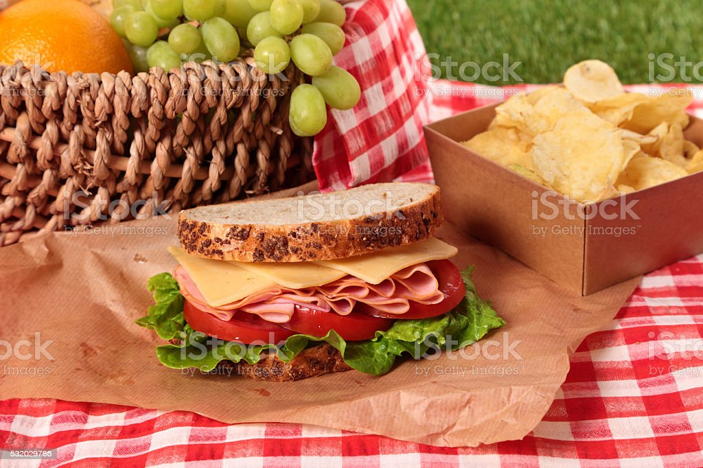 Picnic basket ham and cheese sandwich stock photo