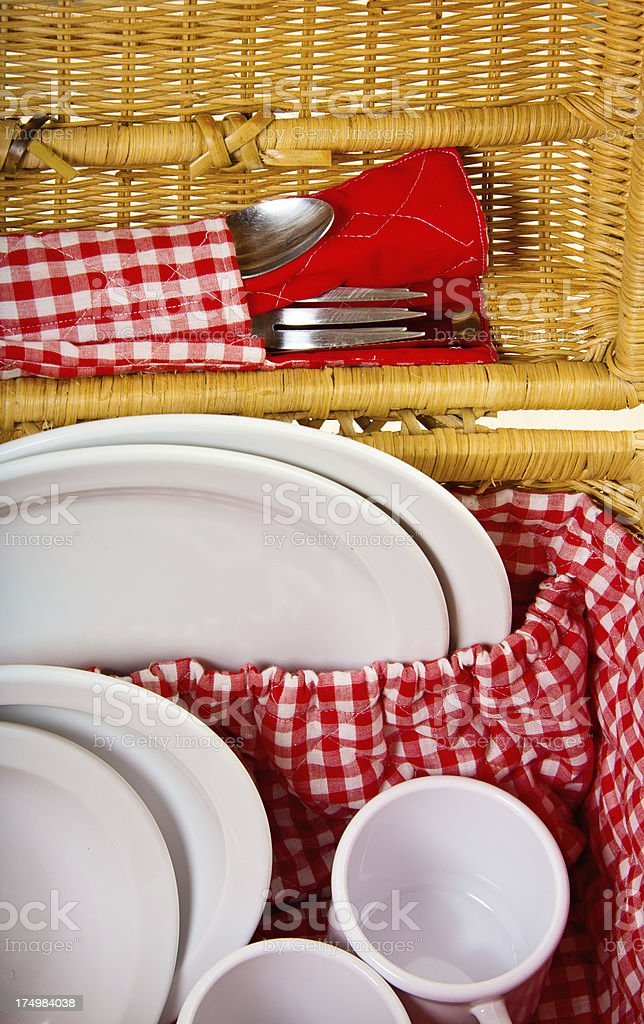 Picnic Basket with Plastic Plates and Utensiles royalty-free stock photo