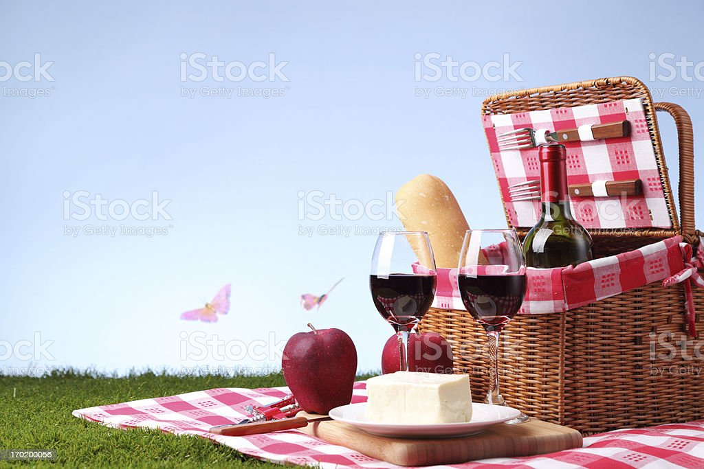 A picnic basket with wine and cheese stock photo