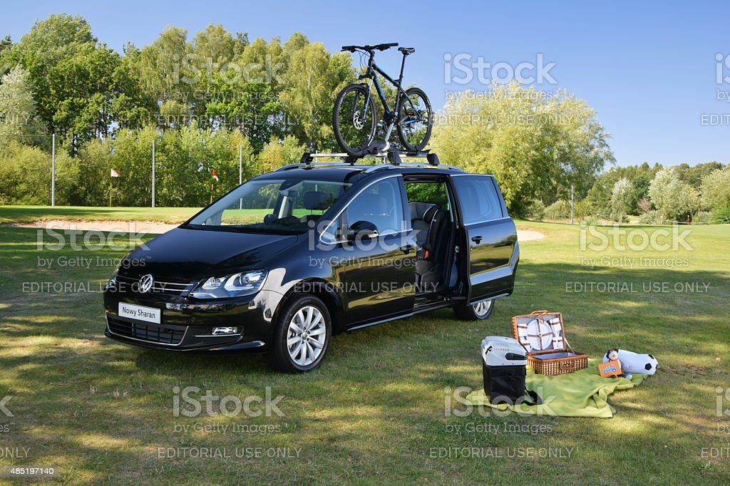 Picnic on the grass with family van stock photo