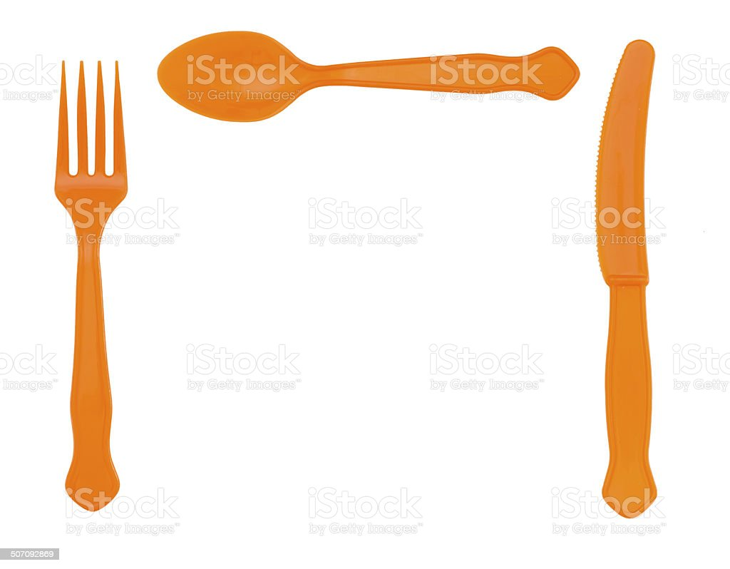 Picnic plastic cutlery - orange colour, knife fork and spoon. stock photo